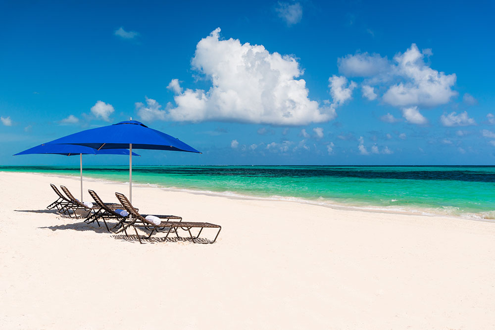 Sailrock-Resort-White-Sand-Beach-and-Loungers-3